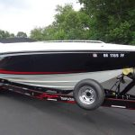 triple axle trailer with four winns boat